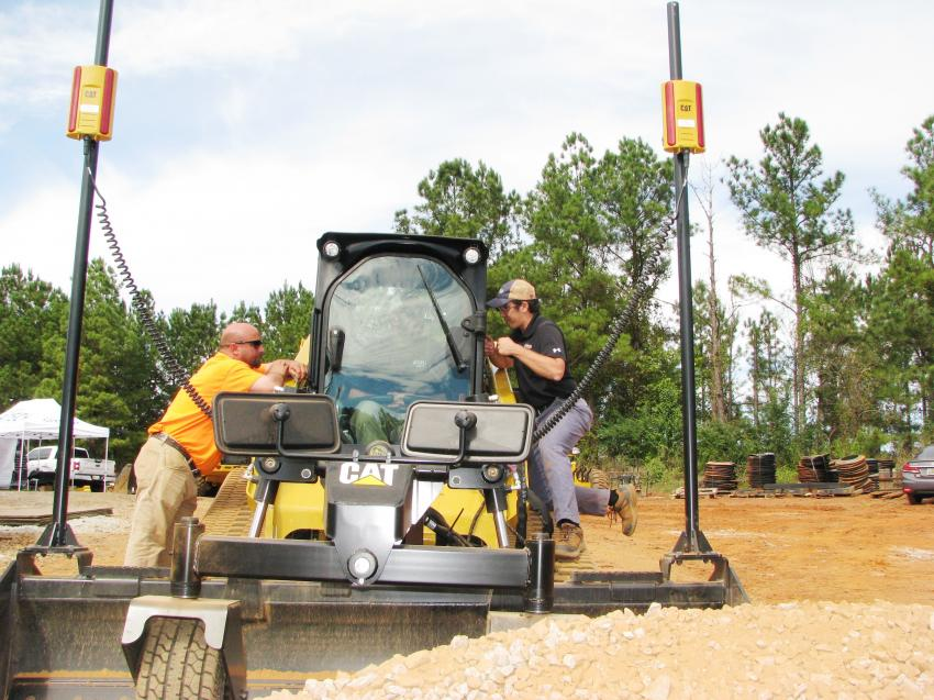 A Cat compact track loader with box blade and Trimble grade control.