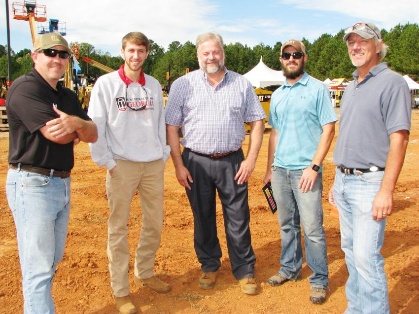 Getting ready to check out the demo machines, some of which they already own, are (L-R) Bryan Wilson and Caleb Dixon of Cooper Barnette & Page (CBP), environmental contractors based in Statham, Ga.; Alex Wood, Yancey Bros. Co.; and Gabe Leach and Vaughn Cheely, also of CBP.