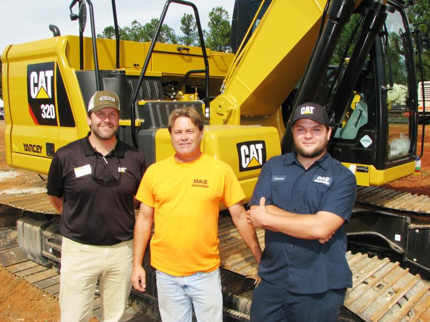 (L-R): Buck Buchanan of Yancey Bros. Co. talks Daniel Bryson and Cameron Bryson, the guys from DAZ Construction, based in Lilburn, Ga., about the purchase of this next-generation Cat 320 excavator to complement their D6N dozer with Grade Control.