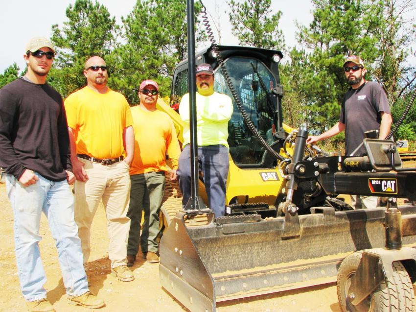 (L-R): Caleb Asher, Paul Asher, Geraldo Laredo, Hugo Guzman and Kevin Myers, a group from Dekalb Pipeline, based in Conyers, Ga., came out to test operate the combo Trimble technology/Cat box blade system for fine grading in tight spots.