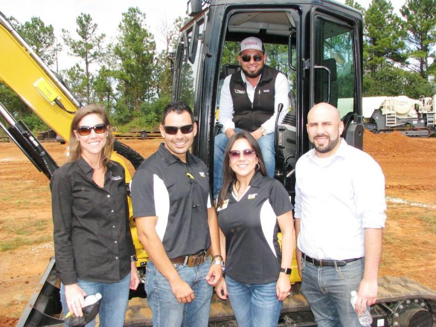 Checking out some of the smaller machines incorporating Trimble technology are (L-R front) Ashley Haynes, Tafolla's Concrete Contractor, Lawrenceville, Ga.; Cesar Gonzalez and Zaira Brumagim of Yancey Bros. Co.; Giovani Serrano of Tafolla's; and Raymond Tafolla (in cab).