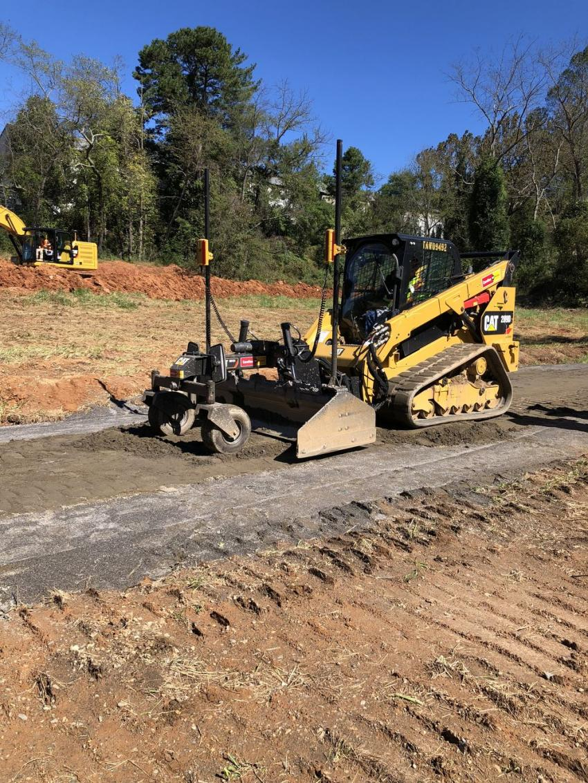 The Cat 289D compact track loader outfitted with Accugrade BB-121 and BB-124 box blade attachments was kept busy by the guests during the event.
