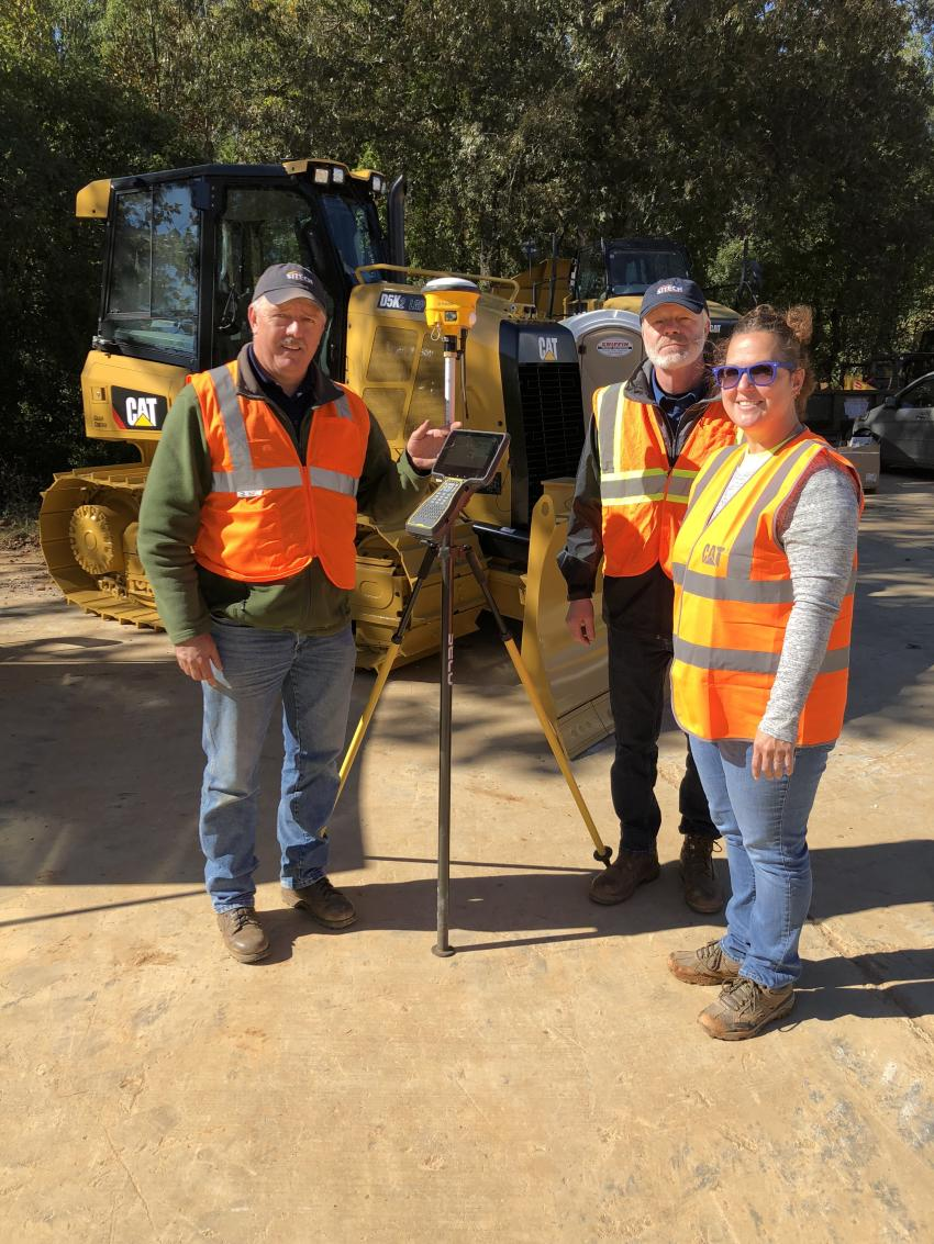 (L-R): Rob Hendrix, Randy Rohrer and  Becky Huskins, all of Sitech Mid-Atlantic,  had the Trimble TSC7 and SPS986 Survey  Rover device out for the customers to look over.