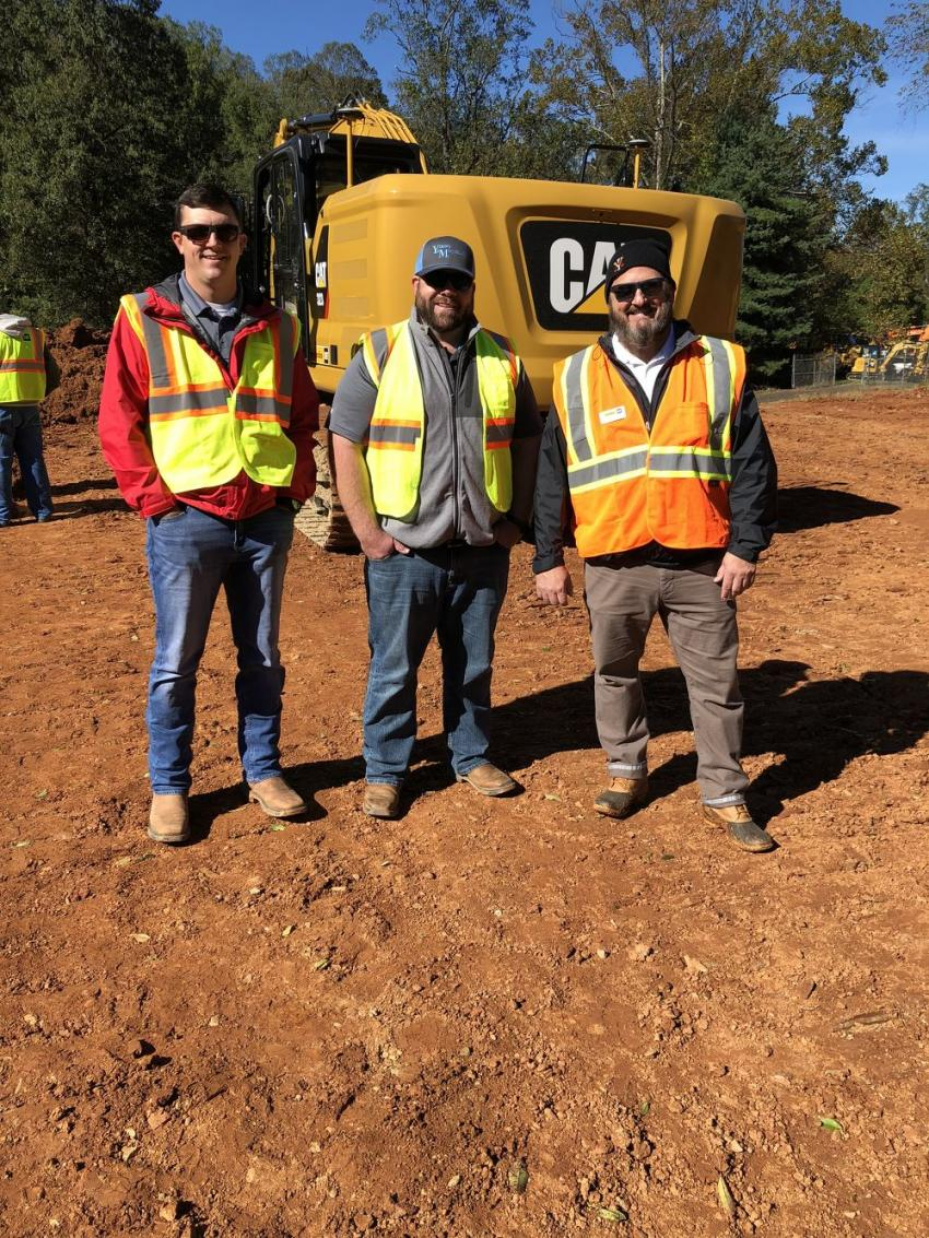(L-R) are Justin Canipe and Adam Tipton, both of Young & McQueen Grading Company in Burnsville, N.C., talk excavators with Mark Kincer, Carolina Cat.