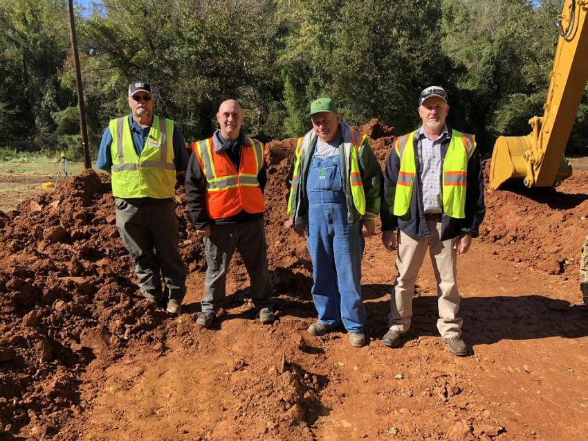 (L-R) are Phil Greene and Robert Bugg, both of Carolina Cat; and David Cassada and Larry Penland, both of Penland Contracting in Franklin, N.C.