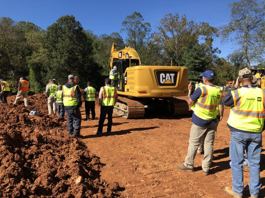 The guests waited to try out the Cat 323 excavator with Standard Grade Assist, which automates boom, stick and bucket movements, so operators stay on grade simply and effortlessly with semi-autonomous digging.