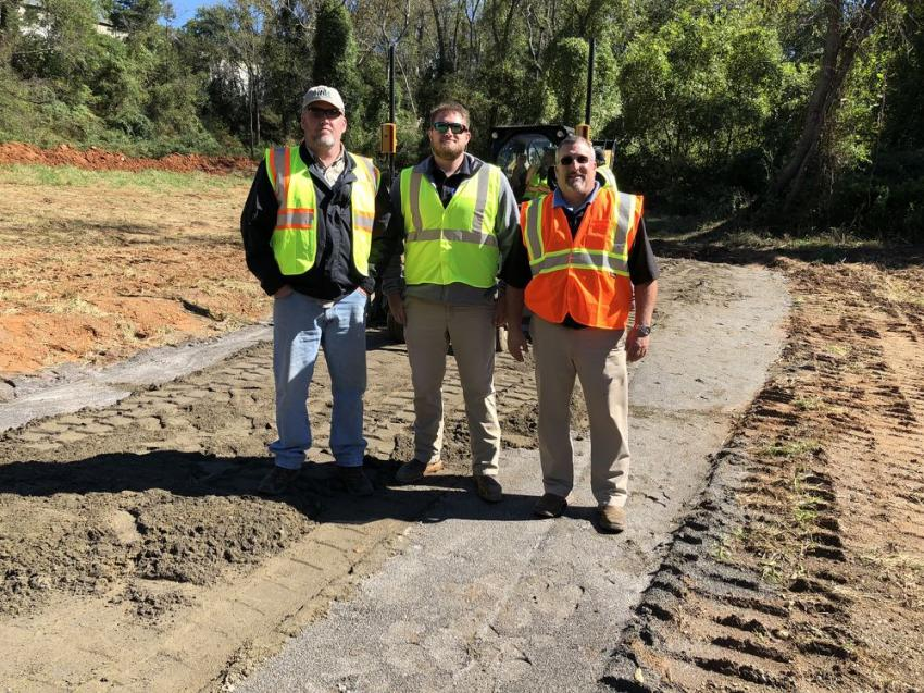 Talking about the Cat Accugrade BB-121 and BB-124 box blades are (L-R) Bobby Jones, HNH Construction, Asheville, N.C.; and Spencer Sain and Ben Patrick, both of Carolina Cat.