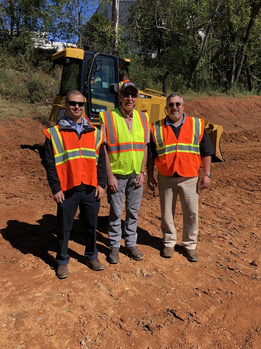 (L-R): Mike Tropsha, Carolina Cat; Mike Cloer of Cherokee Enterprises in Cherokee, N.C.; and Ben Patrick, Carolina Cat, discuss the 3D Grade Control system that is built into the new Cat D6K2 machines.