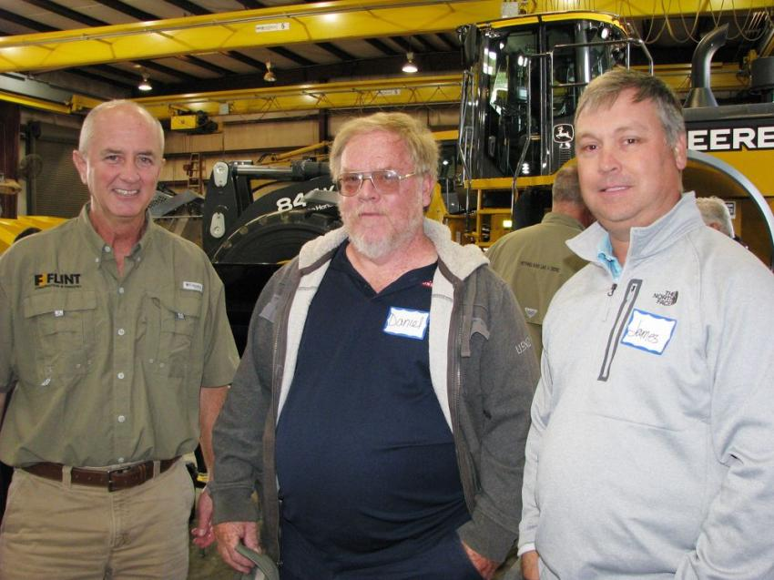 (L-R): Flint Construction & Forestry's Tim Rowe welcomes his friends and customers Daniel Hawk and James Steed of J.H. Hiers Construction, Walterboro, S.C., to the event.