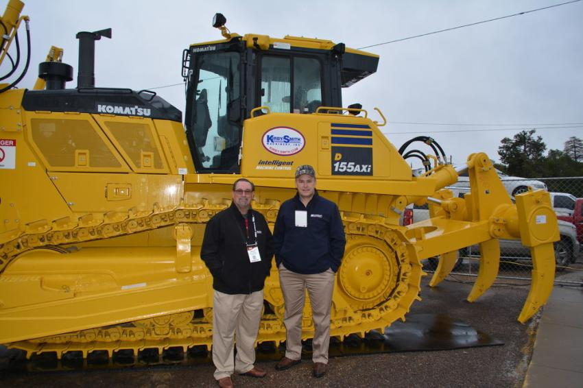 "Chuck Thompson (L), West Texas area manager of Kirby-Smith, and Buck Lawson, senior district manager of Komatsu America Corporation, were available to explain the benefits of Komatsu's D155AXi ""intelligent"" machine."