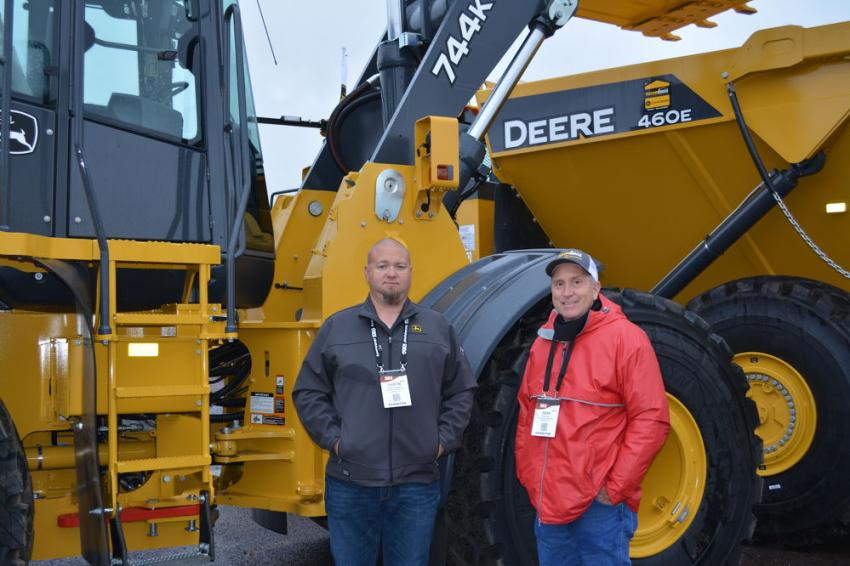 Dean Key (R), product support manager of Yellowhouse Machinery Company, and Dustin Cappers, customer service advisor of the Midland branch, highlighted the advantages of the John Deere 744K loader and 460E articulated dump truck for use in the oilfield.