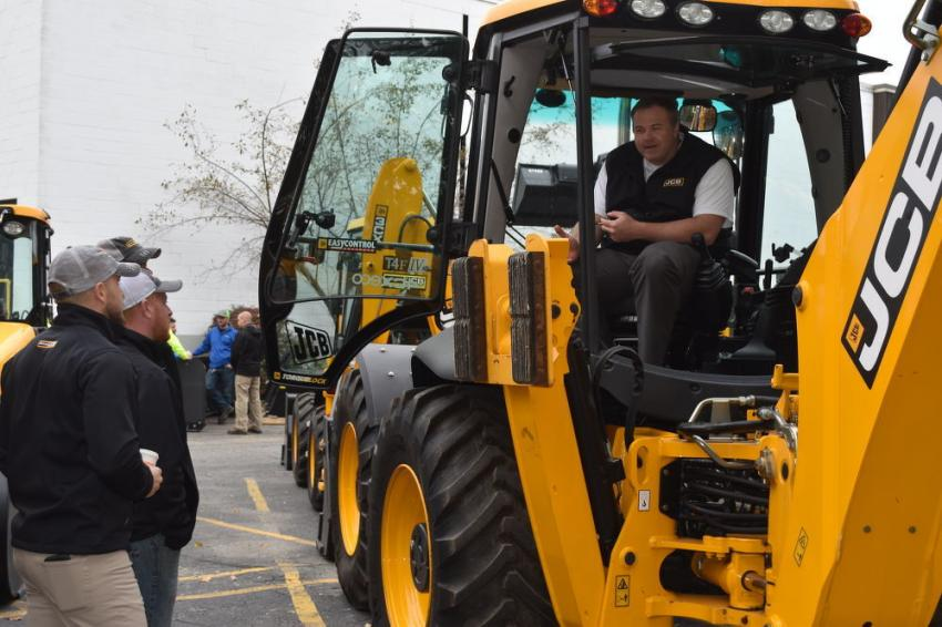 David Pendleton briefs visitors on the JCB model 4CXECO tractor loader backhoe.