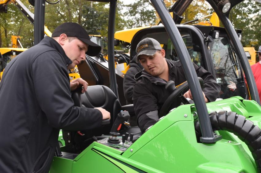 Checking out the features of an Avant 365 articulated loader is Jason Burgess (L) of Green World in Plaistow, N.H., and Ryan Sears, sales representative of Northland JCB.