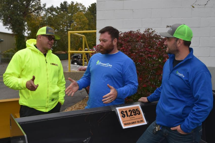 Discussing the challenges of the upcoming snow season (L-R) are Kevin Burke of Northland JCB; and Gregory Cunningham and Jovin Ciarletta, both of Ground Care Landscaping, a landscape and hardscape service, in North Andover, Mass.
