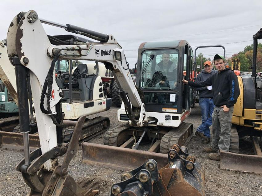 With the boom in construction, compact excavators are in high demand. Checking out the controls of this Bobcat (L-R) are Brett Long (in cab), Lee Shuhi, and Dustin Pagano, all of BLG Property Maintenance.