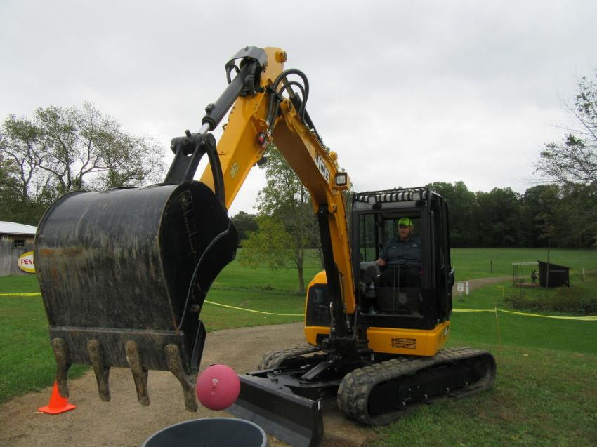 Greene Township's Chris Magee tries his hand at the skill challenge with this JCB 48 Z-1 mini-excavator.