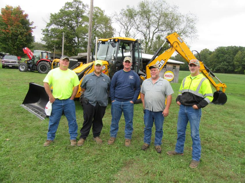 (L-R): Ernie Robinson, Chris Magee and George Erbin of Greene Township joined Steve Goodwill and Ryan Jespersen of Columbus Township to review the JCB machines on display at the event.
