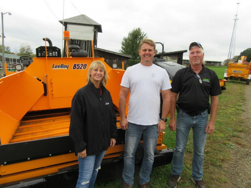 (L-R): Leslie and Eric Bohrer of asphalt contractor Bohrer Enterprises spoke with Stephenson Equipment's Tim Gold about their positive experiences with LeeBoy pavers.