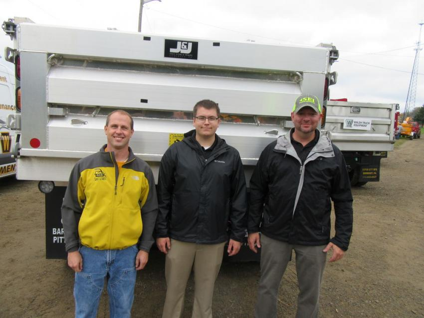(L-R): Erik Kulusa of haF.AST Dirtworks, Conneaut Lake, Pa., caught up with Stephenson Equipment/Walsh Equipment Division's Nick Shaw and Jason Acerra at the event.