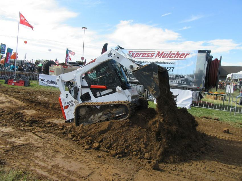 Jake Heshelman of PawPaw Valley Farm, Williams, Ind., puts a Bobcat T650 compact track loader through its paces.