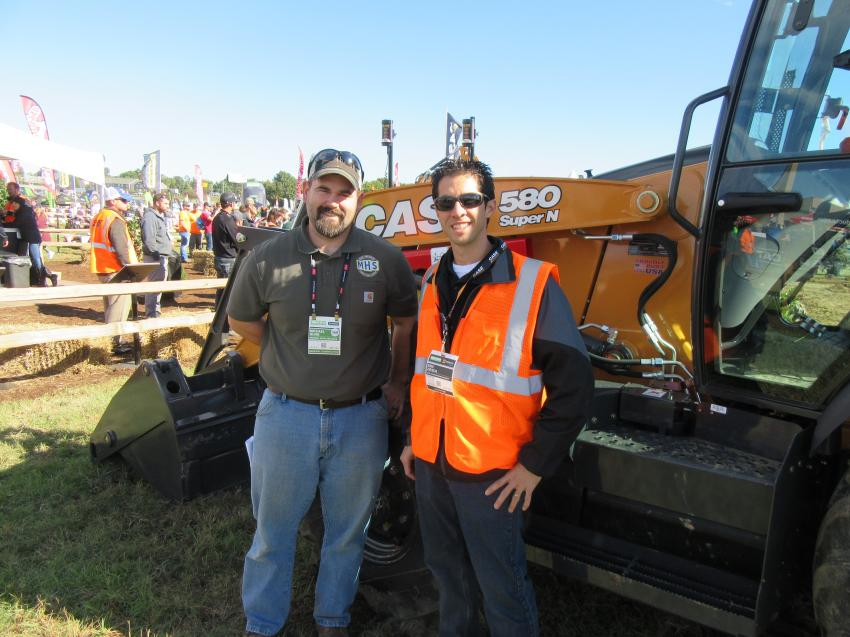 Michael Huhn (L) of Michael Huhn Services was impressed with the handling of this Case 580 Super N backhoe. Here, he gets details on the machine from Eric Zieser of Case Construction Equipment.