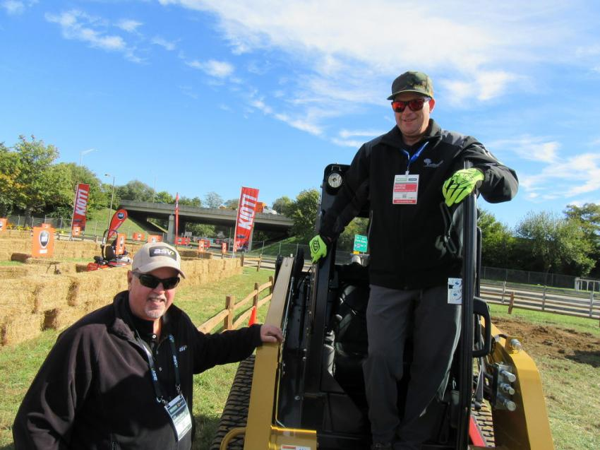 Jim Haroldson (L) of ASV gives Patrick Barton of Earthworks Lawn & Tree, South Dartmouth, Mass., some operating tips on this RT-75 track loader before he tries out the machine.