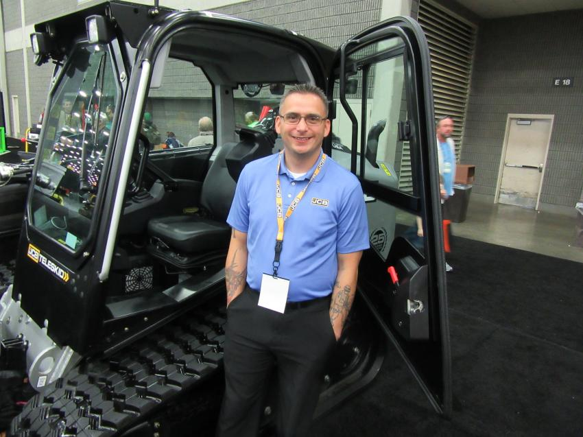 JCB's Chris Trampush was ready to field questions about the company's special edition 3TS-8T compact track loader with a telescopic boom. The company is celebrating 25 years of skid steer innovation.