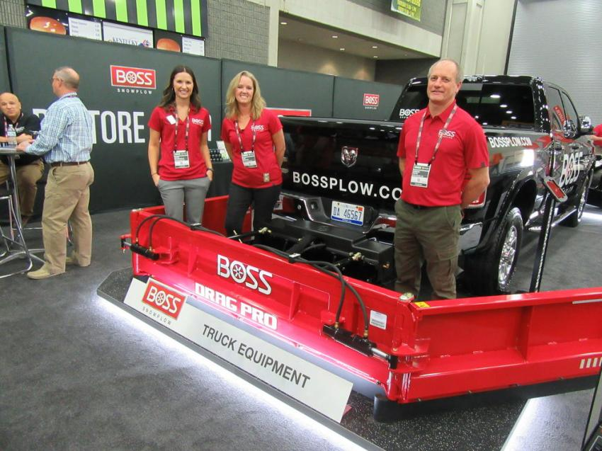 (L-R): At Boss Snow Plow's equipment display, Katie Schinderle, Amy Mendini and Gordie Pepin were ready to talk snow & ice control, including the company's recently introduced DRAG PRO, a rear-mounted truck plow designed to pull snow from the back.