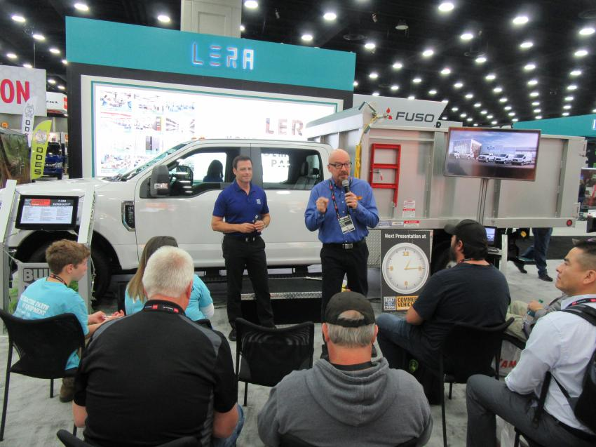 At Ford Commercial Vehicles' exhibit, Joe Popp (L) and Larry Wyatt discuss the company's F-350 upfitted for professional landscape applications.