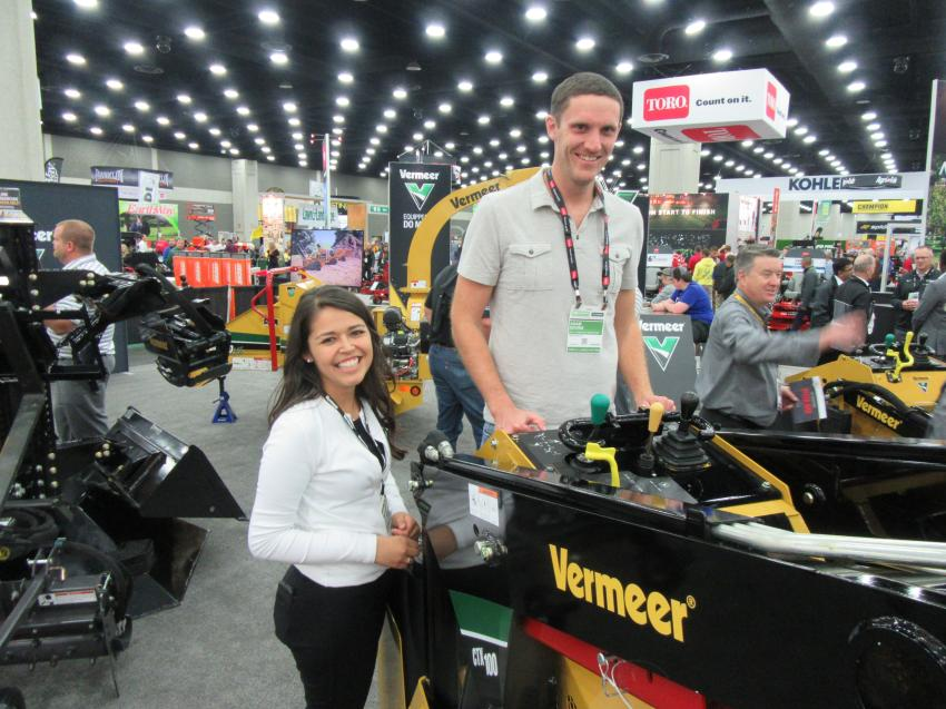 Vermeer's Olivia Carrasco discusses features of the company's CTX100 mini-skid steer with Adam Devins of Kelly Landscape Contracting, Milwaukee, Wis.