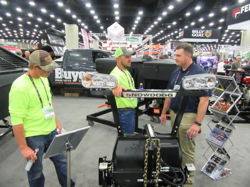 (L-R): Judd Tyson and Matt Menser of Tyson Lawn Care, Nortonville, Ky., spoke with Buyers Product's Dave Zelis about snow and ice control equipment.