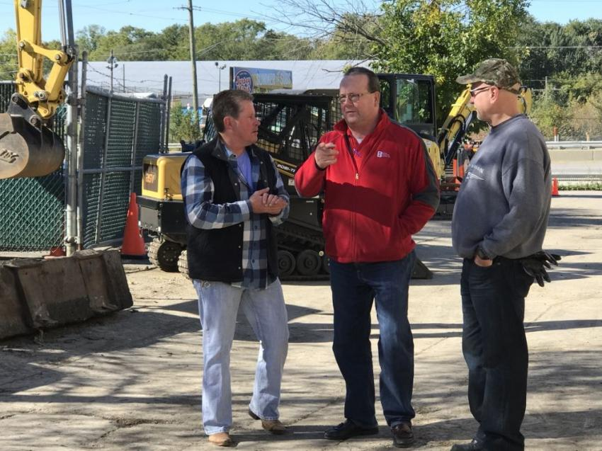 Jack Bone, vice president, Bone Roofing (C), describes his latest jobsite challenges with CE Rentals sales rep David Gordon (L) and The Sandbagger's Tim Vandergrift.