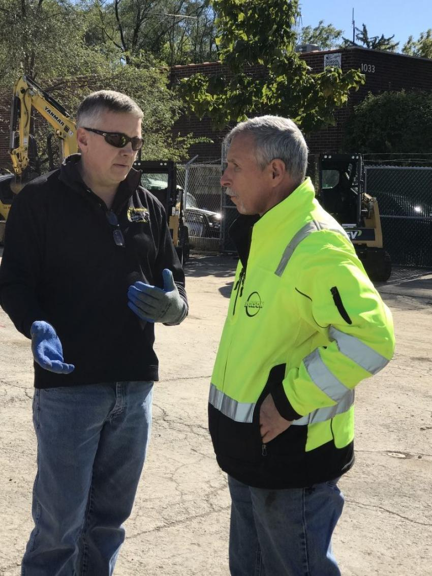 Rob Sloan (L), owner of Contractors Equipment Rentals, talks shop with Olson Construction's Ted Mazurski.