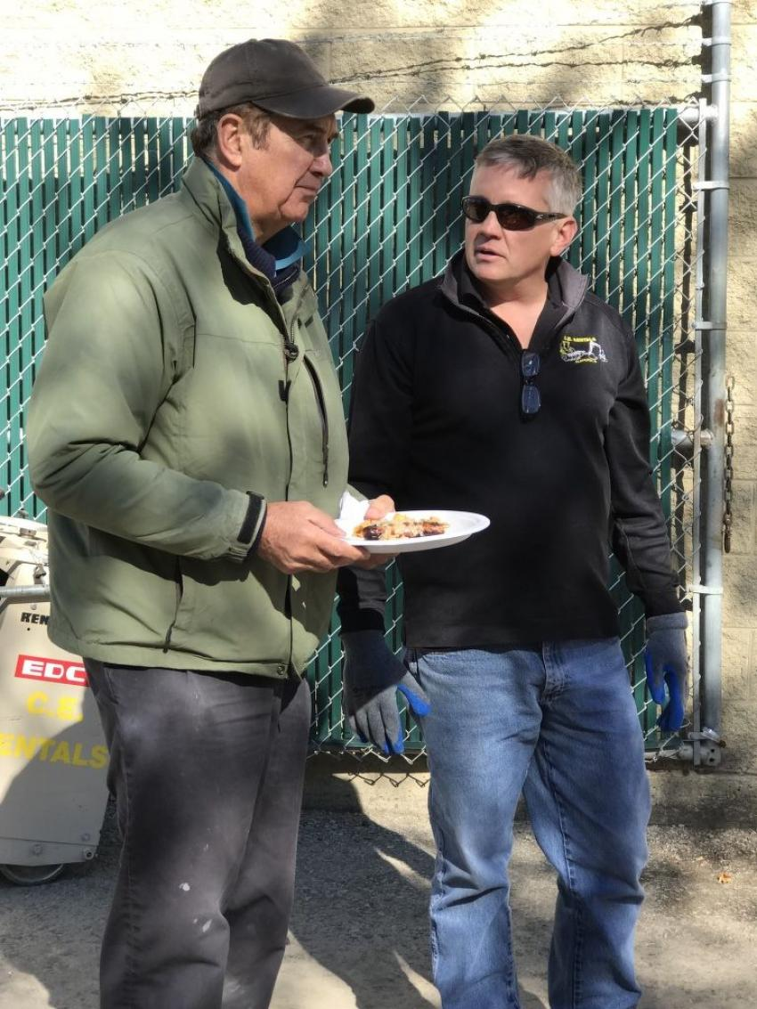 "Rob Sloan of CE Rentals (R) slows down the typical ""Hi-I-gotta-go"" rental rush with customer Peter Soumar, Soumar Masonry, who stopped in for the open house lunch."