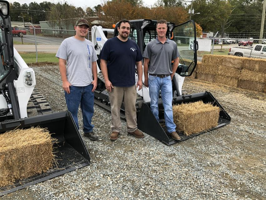 (L-R): Brian Gunter and Brandon Watson, both of Waxhaw Tree Services in Waxhaw, N.C., talk with Brian Porter, Bobcat of Charlotte, about the Bobcat T595 compact track loader.