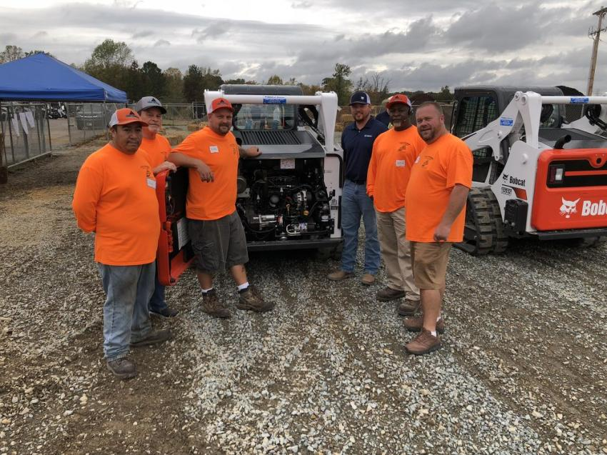 The Bobcat product line has been engineered to make routine service easy. Cody Mullis of Bobcat of Monroe (third from right) goes through it with representatives of H&S Paving in Marshville, N.C., (L-R) Alex Vargas, Tommy James, Mike Shelton, William Walls and Jody Stegall.