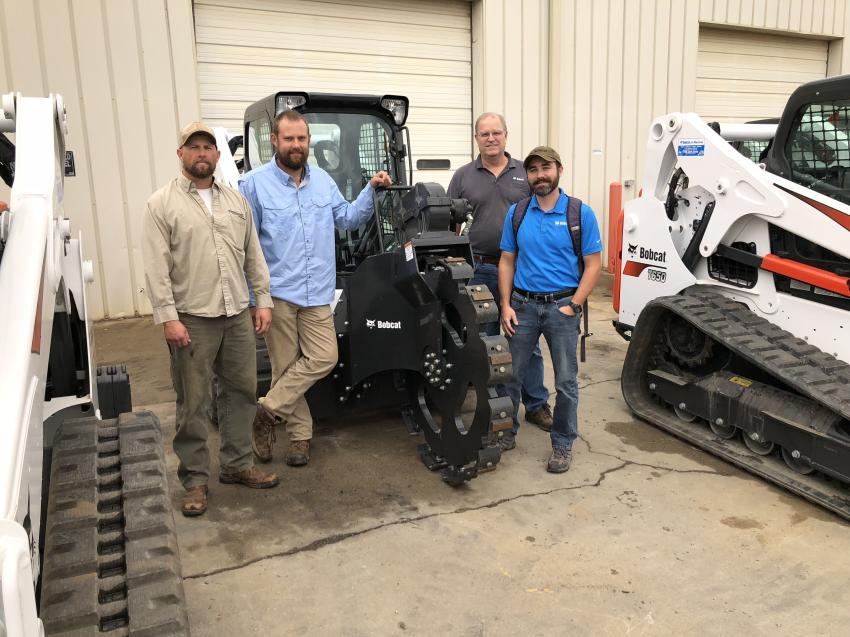 Bobcat offers many different attachments to increase the productivity of its machines. Going over the trench tamp attachment (L-R) are A.J. Waller and Ryan Sloop of Sloop Fence in Mount Ulla, N.C.; Scott Corriher, Bobcat of Charlotte; and John Valentine, Bobcat of Kannapolis.
