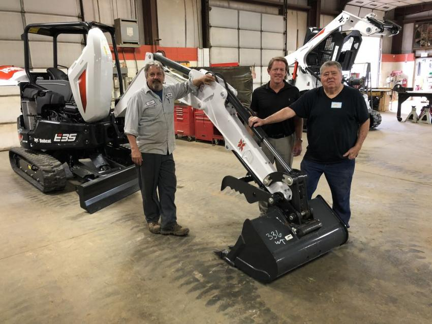 (L-R): John Davis of Bobcat of Monroe; Steve Thigpen, president of Bobcat of Monroe; and John Starkey of Polyreps of Monroe look over the Bobcat E35 excavator.
