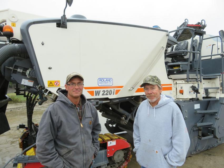 Greg Beyers (L) and Joe Telford, both of Dunn Company, meet in front of the Wirtgen W220i milling machine.