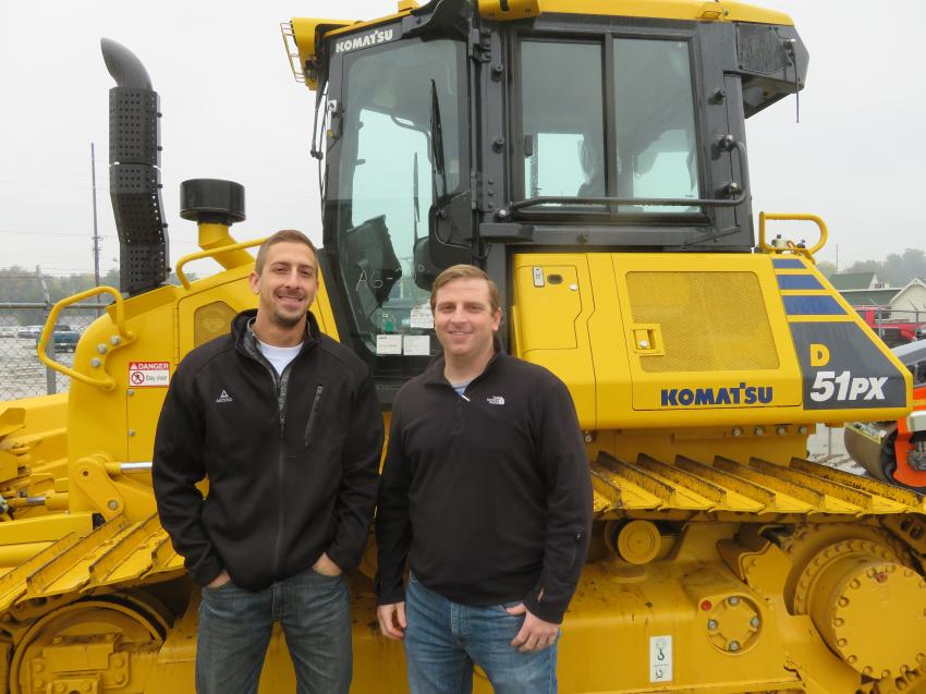 Halverson Construction's Ian Krispin (L) and Ryan Spearie look over a Komatsu D51PX dozer at the open house in Springfield, Ill.