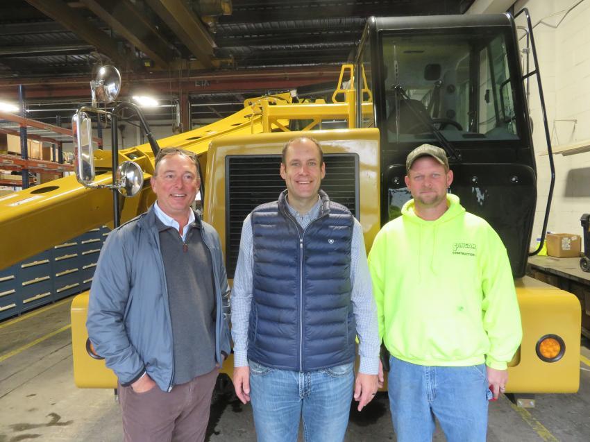 Chris Ingram (C), Roland Machinery Co., talks Komatsu iron with Matt Reyhan (L), vice president of Sangamo Construction, and Rusty Stewart, equipment manager of Sangamo Construction.