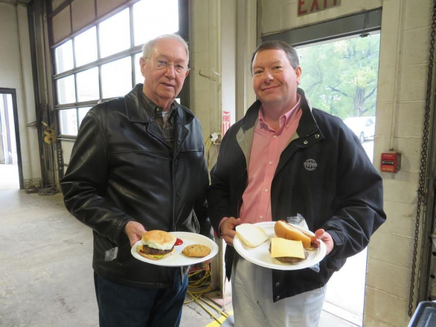 The father-and-son team of Jim and Bob Bruner, United Contractors Midwest (UCM), enjoys the Roland Machinery Co. open house.