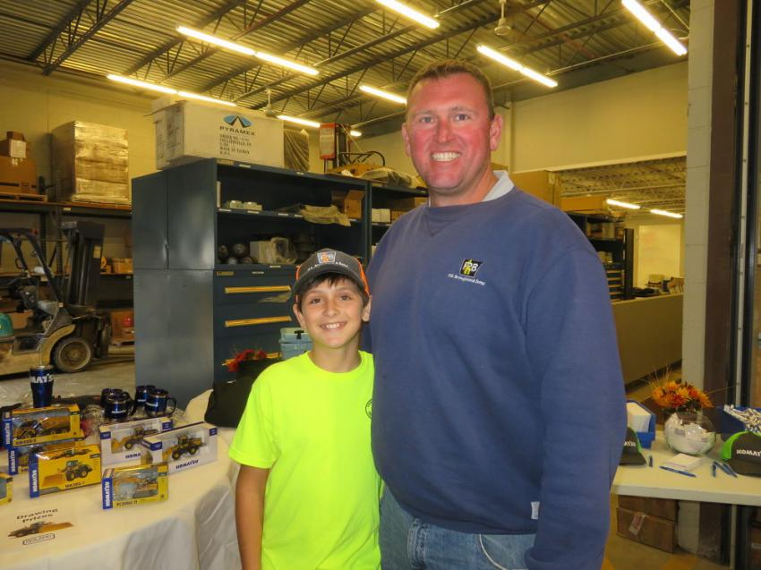 Josh Broughton of P.H. Broughton & Sons brought his son Connor to the open house to check out the Komatsu iron as well as the other lines of equipment Roland Machinery Co. has to offer.