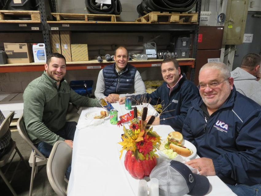 Chris Ingram (second from left), sales manager, Springfield Division, Roland Machinery Co., welcomes (L-R) Micky Mann, Brian Vogt and Russ Carlstron, all of Petersburg Plumbing & Excavation, to the open house.