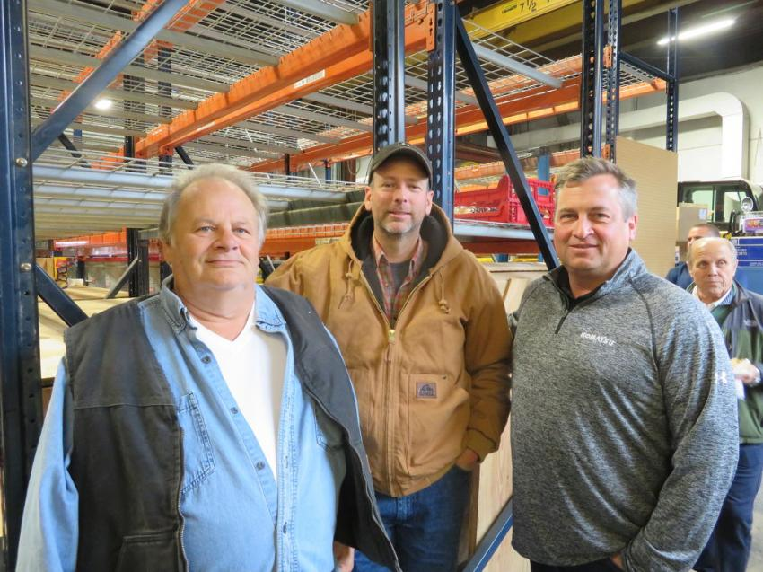 Matt Roland (R), president, Roland Machinery Co., thanks Larry Hagaman (L) and John Gardner, both of Professional Excavating, for coming to the open house and 60th anniversary celebration.