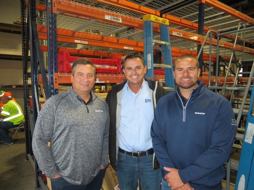 Enjoying the open house and celebrating Roland Machinery Co.'s 60th anniversary (L-R) are company President Matt Roland; John Basham, Otto Baum Co.; and Matt Frans, Roland Machinery Co.