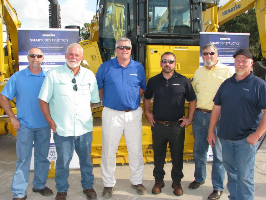 Talking about the new Komatsu intelligent Control Machines at Linder's Plant City open house (L-R) Charles Lupton and Skip Schaer of Schaer Development, Land O'Lakes, Fla.; Randy Thomas and Chris Brazel of Linder; and Bruce Kennedy and Nathan Youmans, also of Schaer Development.