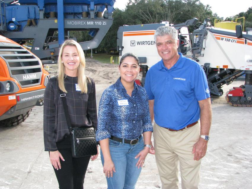 Vince Aguayo (R) of Linder Industrial Machinery welcomes Kristy Hernandez (L) and Jessica Concepcion of BlackRock Asphalt & Milling, Tampa, to the Plant City open house event.