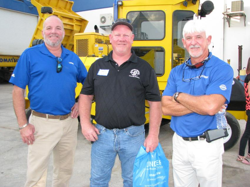 Enjoying some time to chat about the industry after dinner at the Plant City open house (L-R) are Angus Mora, Linder sales; Reggie Watson, Phillips & Jordan Inc., Zephyrhills, Fla.; and Greg Woodard, Linder sales.
