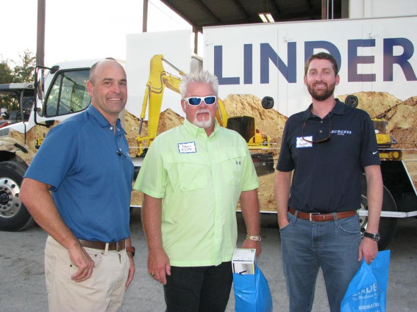 "Talking about machine technology at the Plant City open house (L-R) are Greg Hasty, SITECH North & Central Florida; ""Chef Guy Fieri"" (also known as Robert Turner, Ripa Construction, Tampa); and Ben Burgess, Burgess Civil, Tampa."